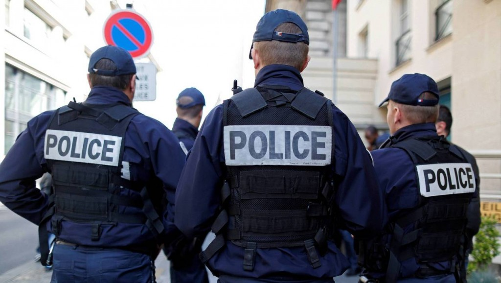 French police gather outside a local police station in Paris after a Molotov cocktail attack over the weekend near Paris that injured their colleagues